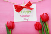 Mothers day card with red tulips — Stock Photo