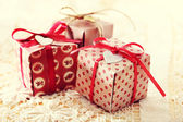 Hand-crafted gift boxes with heart-shaped labels — Stock Photo