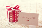 Thinking of you message with red present box  — Stok fotoğraf