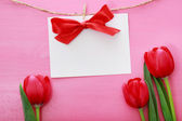 Message card with red tulips — Foto Stock