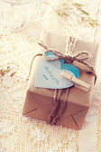 Gift Box with heart-shaped tags — Stock Photo