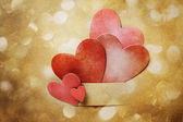 Hand-crafted paper hearts and circle lights — Stock Photo