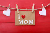 Mothers day message with clothespins over red wooden board  — 图库照片