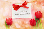 Mothers day card over red tulips — Stock Photo