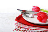 Dishware with red tulips — Stock Photo