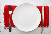 White plate with fork and knife — Stock Photo