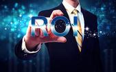 Businessman touching ROI — Stock Photo