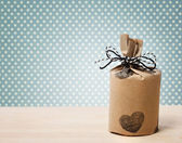 Present wrapped in a rustic earthy style — Stock Photo