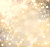 Golden colored abstract shiny light background — Foto Stock