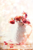 Dried roses in vase  — Stock Photo