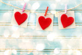 Hand-crafted felt hearts hanging with clothespins — Stock Photo