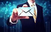 Hombre de negocios con los sobres de correo electrónico — Foto de Stock