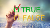 TRUE or FALSE checkbox with hand — Stock Photo