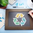Recycle sign on black chalkboard — Stock Photo #50835013