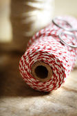Spool of red and white twine — Stock Photo