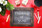 Thinking of You message on chalkboard — Stock Photo