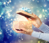 Magical glowing present box — Stock Photo