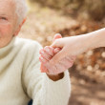 Senior woman holding hands — Stock Photo #51527055