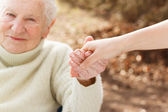 Senior woman holding hands — Stock Photo