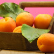 Ripe apricot in a basket — Stockfoto