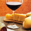 Selection of cheese and ham with glass of red wine — Stock Photo #12080605