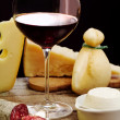 Stock Photo: Selection of dairy product, salami and red wine