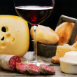 Salami, dairy products and red wine — Stock Photo