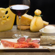 图库照片: Selection of dairy product, salami, Parmham and red wine