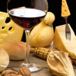 Autumnal table with red wine and cheese selection — Stock Photo