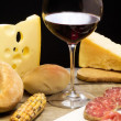 Foto de Stock  : Selection of dairy product, salami, Parmham and red wine