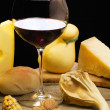 Red wine with cheese selection with autumnal decoration — Stock Photo