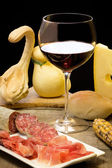 Cheese, ham and wine with autumnal decorations — Стоковое фото