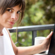 Woman with laptop in outdoor scene - Stock Photo