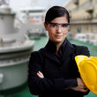 Female naval engineer against  ship background — ストック写真