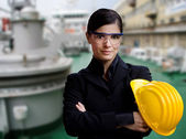 Female naval engineer against ship background — Stock Photo