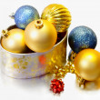 Christmas balls inside a golden box - Stock Photo