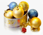 Christmas balls inside a golden box — Stock Photo