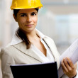 Female architect against interiors background - Stock Photo