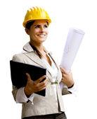 Ingeniero sonriente con casco y planos — Foto de Stock