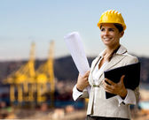 Female naval engineer against shipyard — Stock Photo