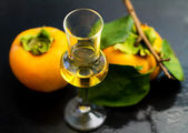 Persimmon liqueur — Stock Photo