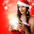 Christmas girl opening sparkling gift box — Stock Photo