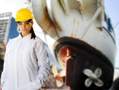 Female naval worker at shipyard — Stock Photo