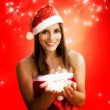 Christmas girl holding sparkling stars — Stock Photo