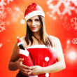 Christmas girl wirh champagne funny bottle — Stock Photo