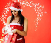 Beautiful girl dressed santa claus opend christmas gift — Stockfoto