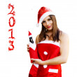 Christmas girl with champagne bottle — Stok fotoğraf
