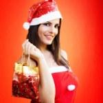 CHRISTMAS GIRL WITH CHRISTMAS GIFT — Stock Photo #16247593