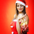 Magic christmas gift holding by beautiful santa claus — Stockfoto