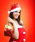 CHRISTMAS GIRL WITH CHRISTMAS GIFT — Stock Photo